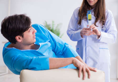 Funny man getting ready for syringe shot