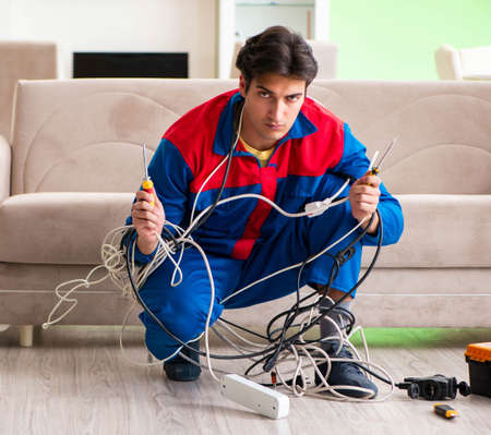 Electrician contractor with tangled cables messy