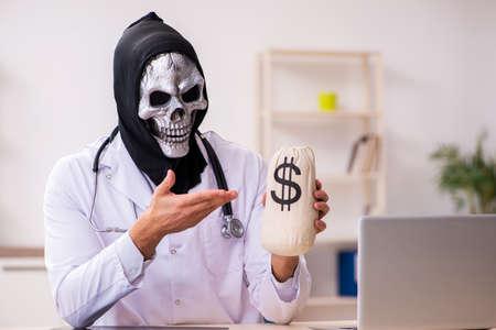 Male devil doctor in expensive medicine concept
