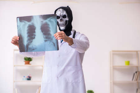Male devil doctor radiologist working in clinic