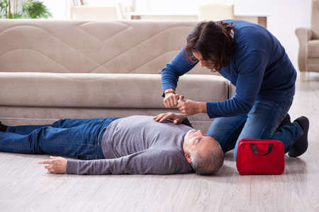 Grandfather and grandson in first aid concept Stock Photo