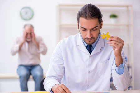 Doctor and patient suffering from Alzheimer disease