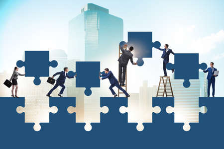 Businessman in the teamwork concept with jigsaw puzzle