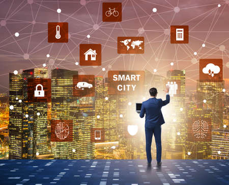 The concept of smart city with businessman pressing buttons
