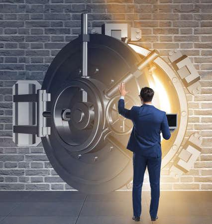 The businessman in front of banking vault door