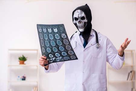 Male devil doctor radiologist working in clinic Foto de archivo