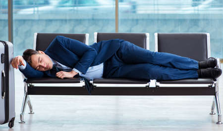 Businessman waiting at the airport for his plane in business cla Archivio Fotografico
