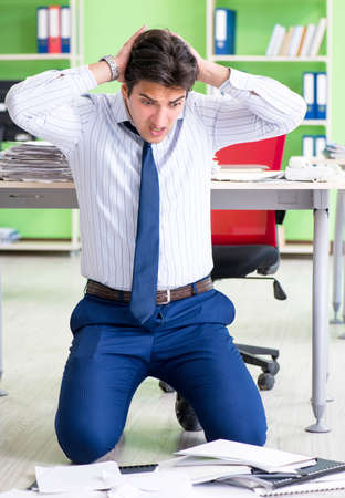 Frustrated businessman stressed from excessive work Archivio Fotografico