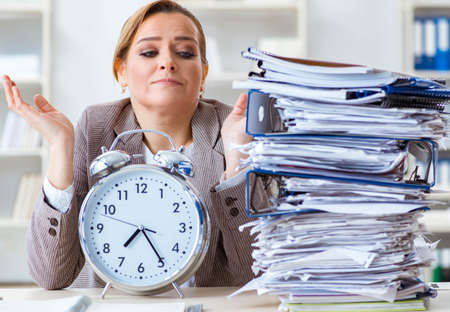 Businesswoman workaholic trying to finish urgent paperwork