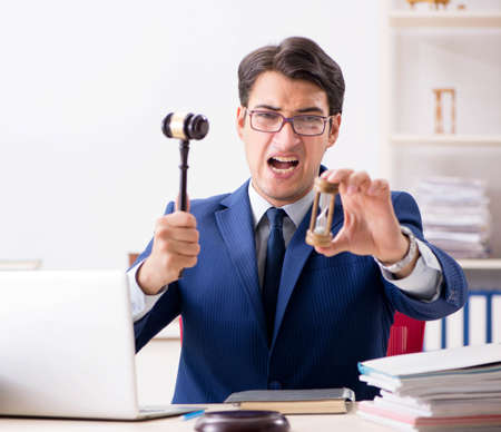 Young handsome judge working in court Stockfoto