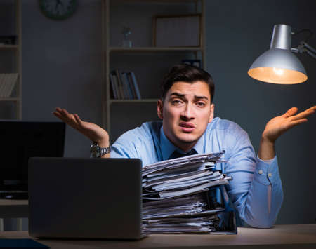 Employee working late at night at important report