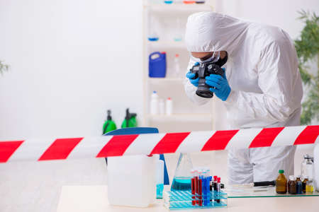 Young male chemist working in medicine lab