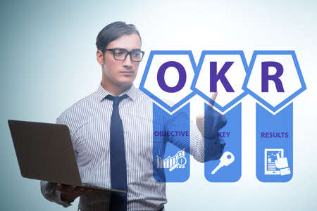 OKR concept with objective key results and businessman Reklamní fotografie