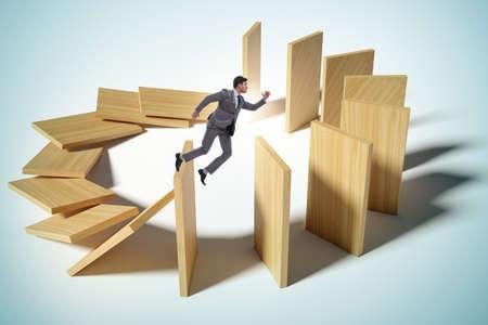 Businessman in domino effect concept 写真素材