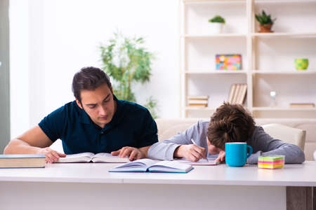 Father and son in exam preparation concept