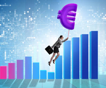 The businesswoman flying on euro sign inflatable balloon