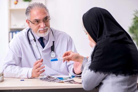 Arab woman visiting experienced doctor Foto de archivo