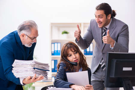 Two male and one female employees working in the office