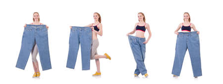 Woman with large jeans in dieting concept Reklamní fotografie