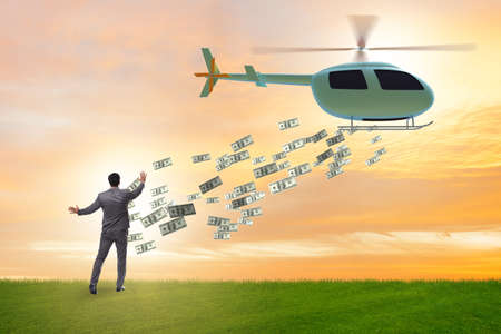 Helicopter money concept with businessman Banque d'images - 151431233