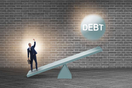 Debt and loan concept with businessman and seesaw