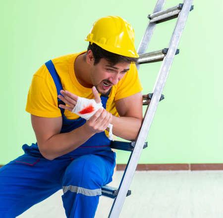 Injured worker at the work site Standard-Bild