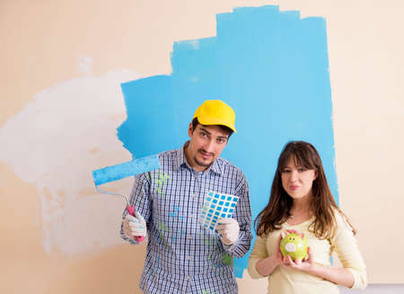 Husband and wife doing renovation at home 写真素材
