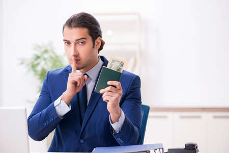 Young man receiving bribery for visa approval