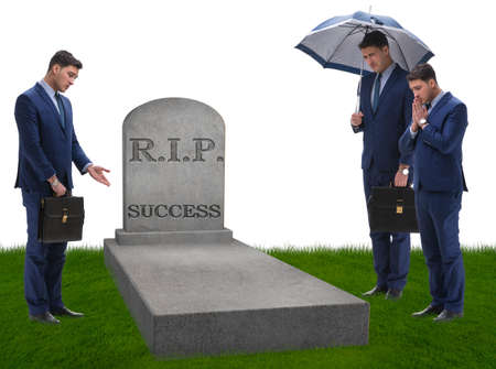 Businessman mourning the death of success Stock Photo