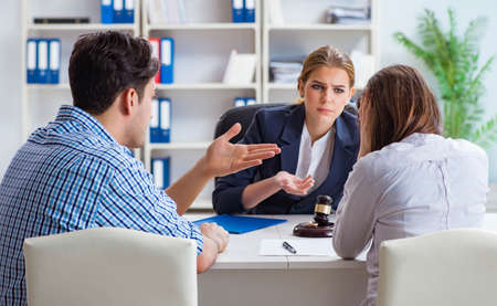 Young family filing divorce papers with lawyer