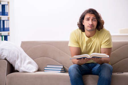 Young male student preparing for exams at home Stockfoto