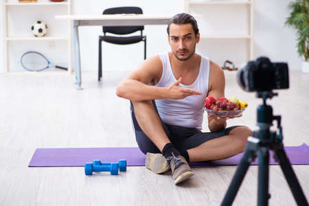 Young male blogger in dieting concept