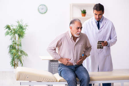 Old patient visiting young male doctor