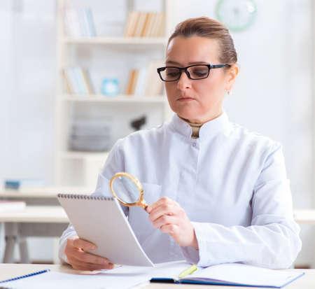 Woman doctor studying human skeleton