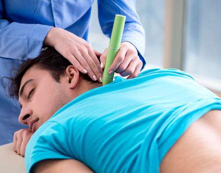 Patient in clinic undergoing laser scar removal Banco de Imagens