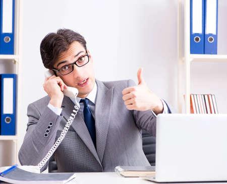 Businessman employee talking on the office phone Foto de archivo