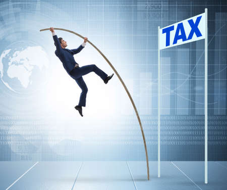 Businessman jumping over tax in tax evasion avoidance concept Stock Photo