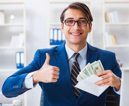 Businessman receiving his salary and bonus Stock Photo