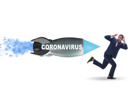 Concept of covid crisis with businessman chased by rocket