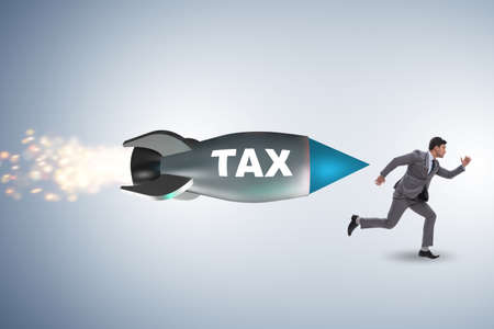 Concept of tax with businessman chased by rocket