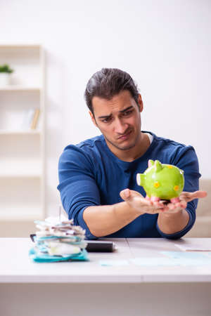 Young man in budget planning concept