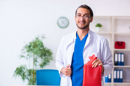 Young male doctor gastroenterologist working in the clinic