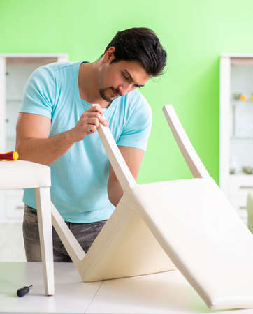 Man repairing furniture at home 写真素材