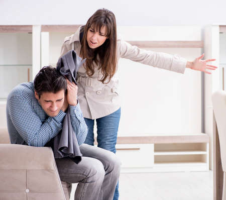 Young couple disappointed with price in furniture store Stock Photo