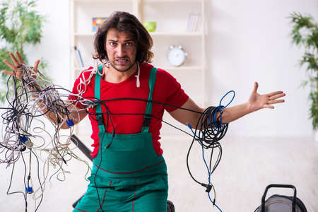 Funny young male electrician working indoors Stock fotó