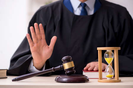 Young male judge in time management concept