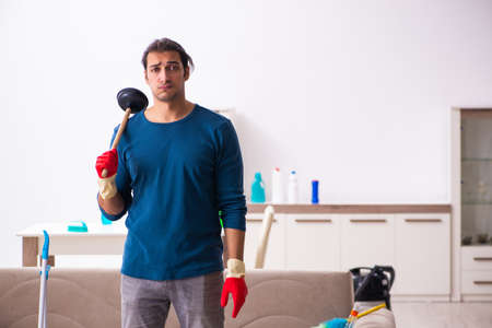 Young man husband doing plumbing at home