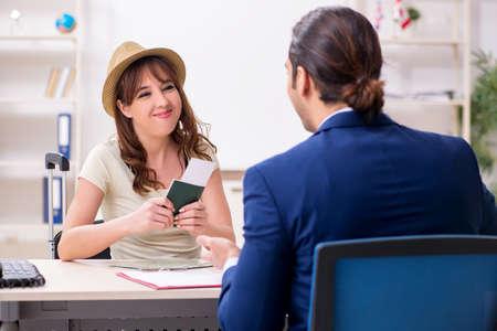 Young woman visiting embassy for visa