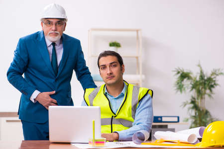 Two male architects working in the office Stock fotó