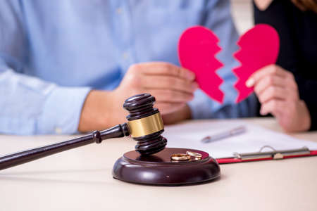 Young pair in courthouse in divorcing concept